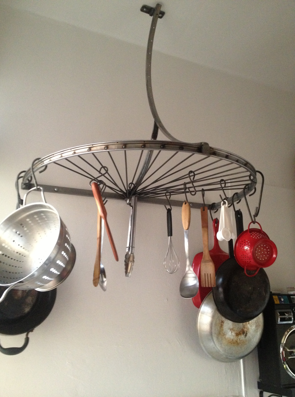 pot rack, potrack, nela, bike rim, kitchen, storage, solutions, interior design, elegant, curved, installation, koreatown, nela, los angeles, highland park